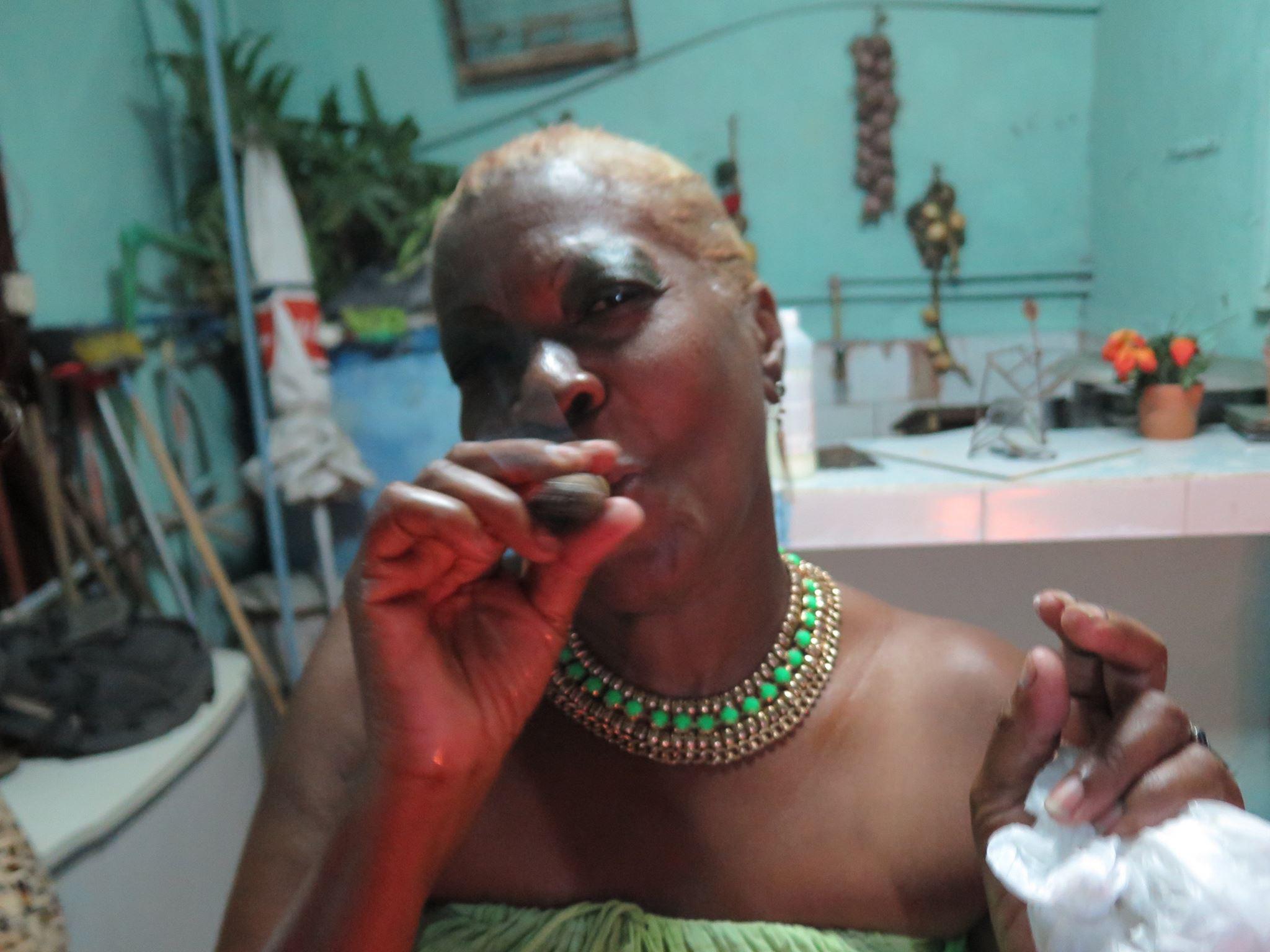 san lazaro, saint lazaro, celebration, worship, religion, santeria, catholicism, catholic, cuba, cuban, cuban streets, cuban celebration, streets of cuba, saint, patron saint of suffering, caribbean island, worshippers, woman, cigar, cuban cigar, cigars, woman smoking, woman smokes cigar. cuban woman smokes cigar