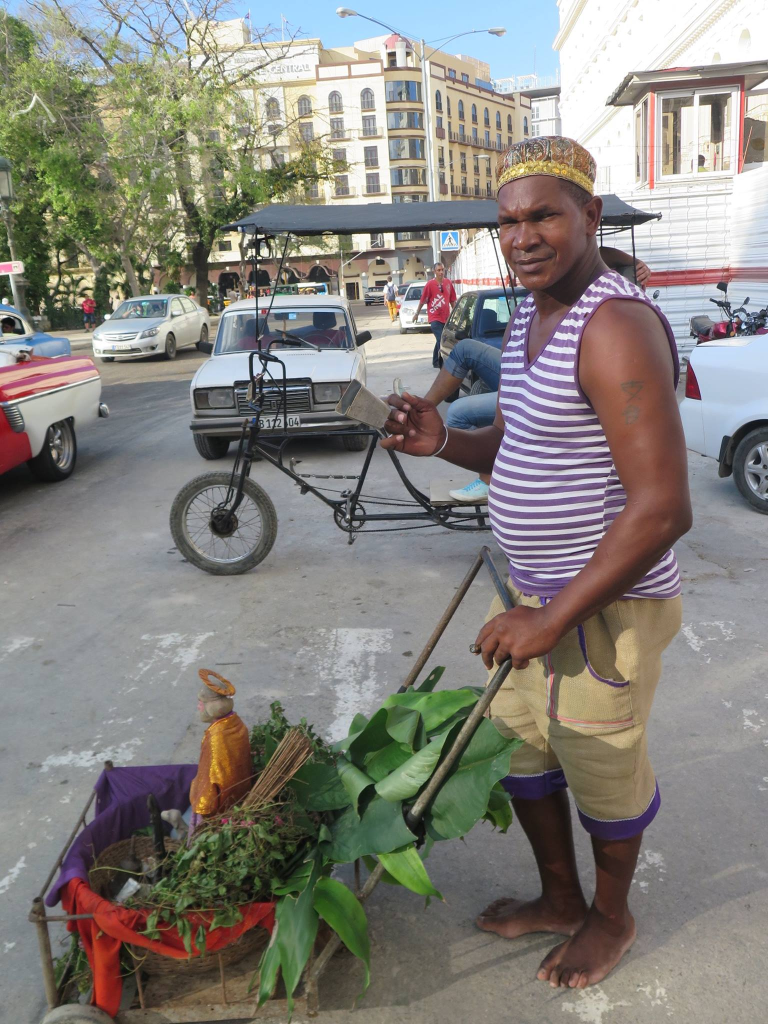 san lazaro, saint lazaro, celebration, worship, religion, santeria, catholicism, catholic, cuba, cuban, cuban streets, cuban celebration, streets of cuba, saint, patron saint of suffering, caribbean island, worshippers, food, vegetables, man, produce,